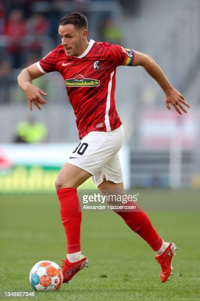 Christian Günter of Freiburg runs with the ball during the Bundesliga match between Sport-Club Freiburg and RB Leipzig at SC-Stadion on October 16,...
