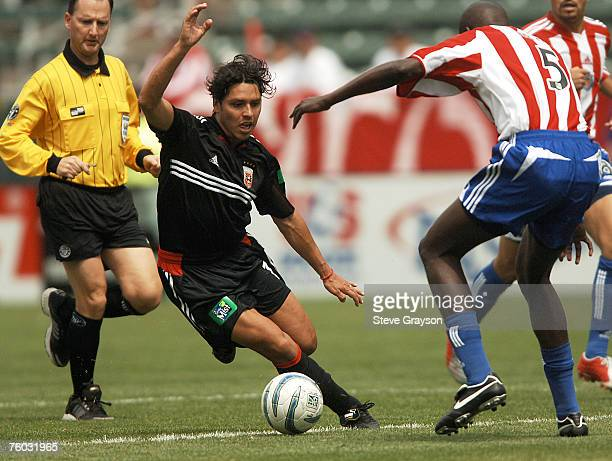 Christian Gomez of D.C. United and Ezra Hendrickson of CD Chivas USA in action at the Home Depot Center in Carson, California April 2, 2005.