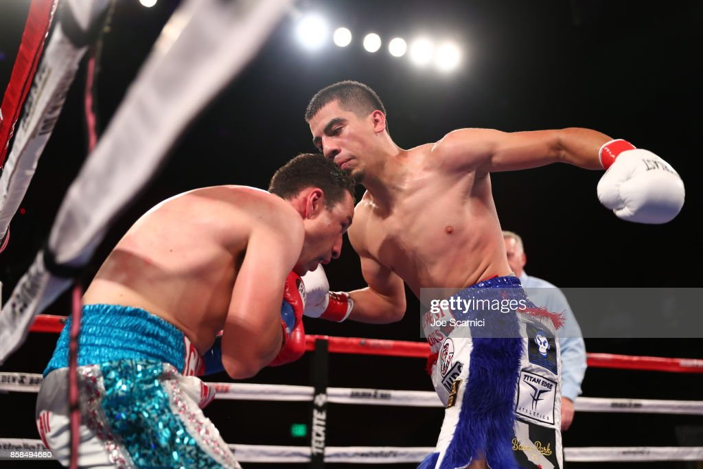Christian Gonzalez throws a punch at Gamaliel Diaz in the sixth round during their Super Lightweight fight at Belasco Theatre on October 6, 2017 in Los Angeles, California.