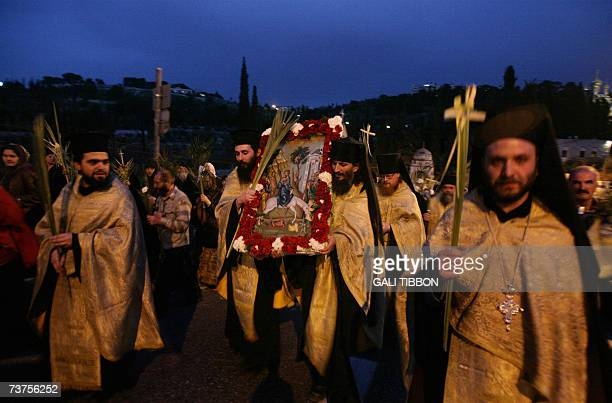 Christian Greek Orthodox priests carry palm branches and an icon of Jesus Christ riding a donkey as he enters Jerusalem during the Palm Sunday...
