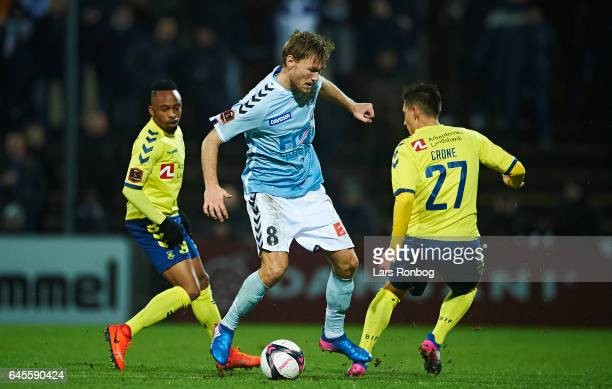 Christian Greko Jakobsen of Sonderjyske and Svenn Crone of Brondby IF compete for the ball during the Danish Alka Superliga match match between...
