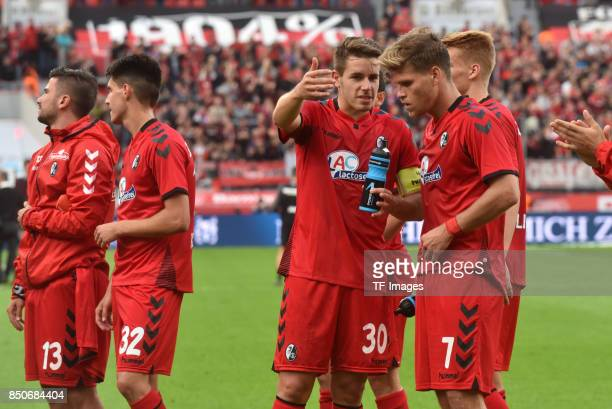Christian Guenter and Florian Niederlechner and Marco Terrazzino and Bartosz Kapustkalooks on during the Bundesliga match between Bayer 04 Leverkusen...