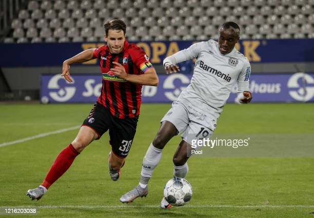 Christian Guenter of Freiburg in action against Moussa Diaby of Leverkusen during the Bundesliga match between Sport-Club Freiburg and Bayer 04...