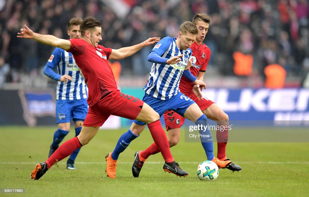 Christian Guenter of SC Freiburg, Mitchell Weiser of Hertha BSC and Janik Haberer of SC Freiburg during the Bundesliga match between Hertha BSC and SC Freiburg at Olympiastadion on March 10, 2018 in Berlin, Germany.