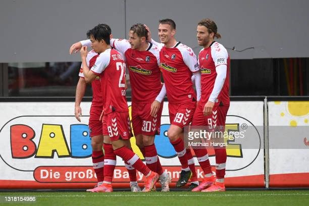 Christian Guenter of Sport-Club Freiburg celebrates with team mates after scoring their side's second goal during the Bundesliga match between...