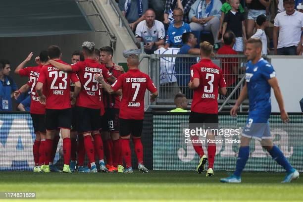 Christian Guenter of SportClub Freiburg celebrates with teammates after scoring his team's first goal during the Bundesliga match between TSG 1899...