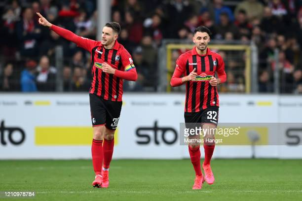 Christian Gunter of Sport-Club Freiburg celebrates scoring his team's second goal with team mate Vincenzo Grifo during the Bundesliga match between...