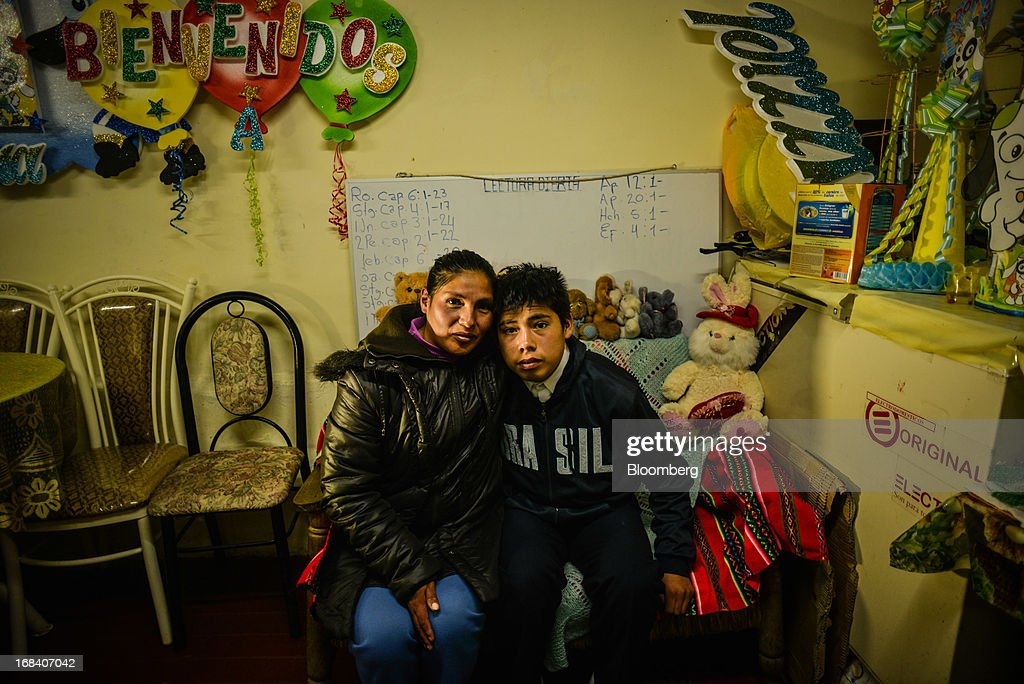 Christian Gutierrez Leon, who is 14 but remains in 5th grade with 9-year-olds because he struggles in school, sits with his mother in the town of La Oroya, Peru, on Wednesday, March 20, 2013. Most of La Oroyaís children suffer elevated lead levels, according to the Peruvian government. The question of responsibility for lead pollution in La Oroya is at the center of high-stakes clash between Peru and U.S. billionaire Ira Rennert, who owned Doe Run Peru for more than a decade through Renco Group Inc., a metals, mining and industrial conglomerate based in New York that has said it is not responsible for the childrenís ills. Photographer: Meridith Kohut/Bloomberg via Getty Images