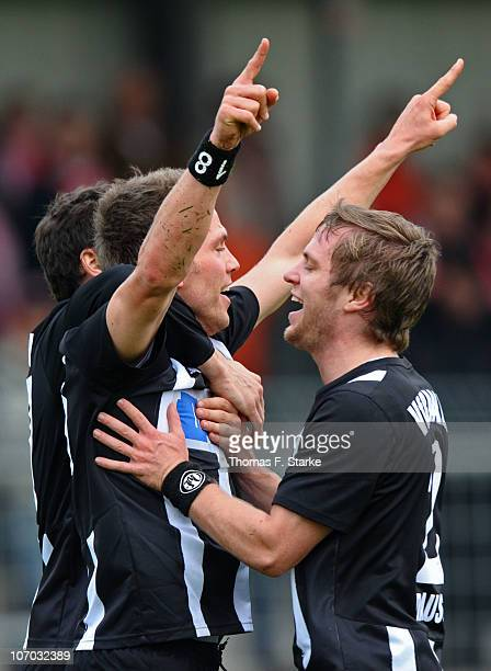 Christian Haas and Martin Dausch of Aalen celebrate their teams second goal during the Third League match between Rot Weiss Ahlen and VfR Ahlen at...