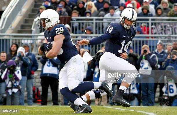 Christian Hackenberg hands off to Zach Zwinak of the Penn State Nittany Lions against the Nebraska Cornhuskers during the game on November 23 2013 at...