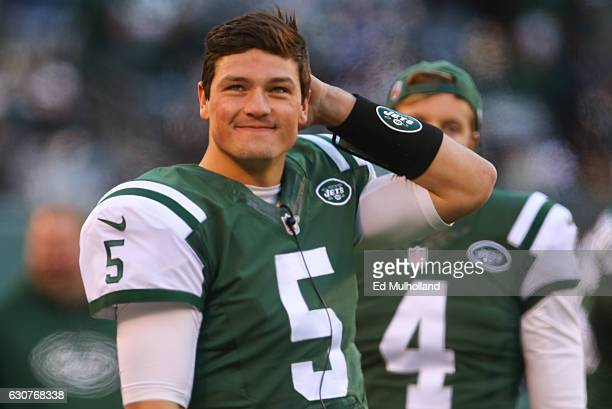 Christian Hackenberg of the New York Jets watches from the sidelines during the second half of their game against the Buffalo Bills at MetLife...
