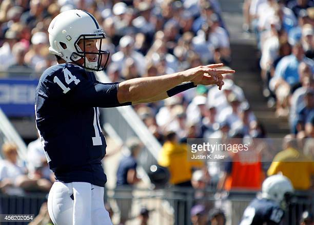 Christian Hackenberg of the Penn State Nittany Lions directs the offense in the first half against the Northwestern Wildcats during the game on...