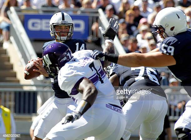 Christian Hackenberg of the Penn State Nittany Lions drops back to pass under pressurein the first half against the Northwestern Wildcats during the...