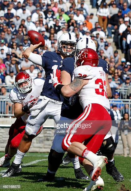 Christian Hackenberg of the Penn State Nittany Lions drops back to pass under pressure against the Indiana Hoosiers during the game on October 10...