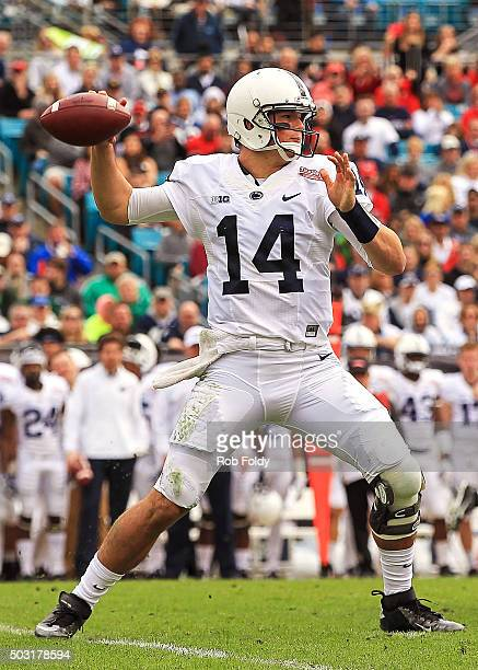 Christian Hackenberg of the Penn State Nittany Lions drops back to throw during the first half of the TaxSlayer Bowl game against the Georgia...
