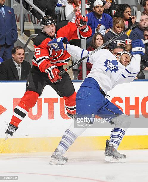 Christian Hanson of the Toronto Maple Leafs is checked by Colin White of the New Jersey Devils during game action February 2 2010 at the Air Canada...