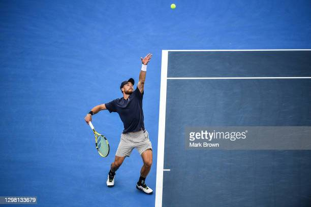 Christian Harrison serves to Hubert Hurkacz of Poland during the Semifinals of the Delray Beach Open by Vitacost.com at Delray Beach Tennis Center on...