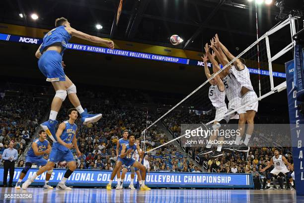 Christian Hessenauer hits the return ball against Nick Amado Kyle Ensing and TJ DeFalco of the Long Beach State 49ers during the Division 1 Men's...