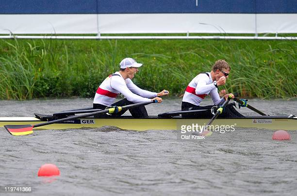 Christian Hochbruck and Mathias Arnold of Germany celebrate winning the Lightweight Men's Double Sculls during Day Five of the FISA World Rowing...