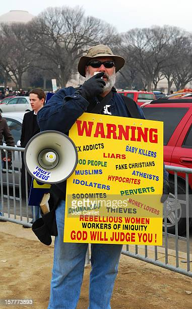 fundamentalist christian preaching with bullhorn in washington dc - fundamentalism stock photos and pictures