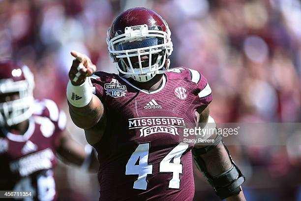 Christian Holmes of the Mississippi State Bulldogs reacts to a special teams stop against the Texas AM Aggies during a game at Davis Wade Stadium on...