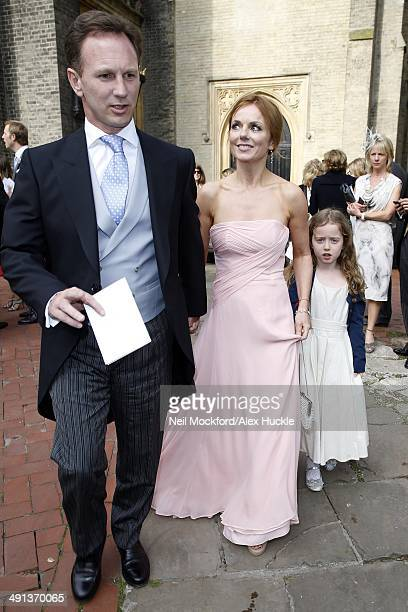 Christian Horner Geri Halliwell and her daughter Bluebell leaving the wedding of Poppy Delevingne and James Cook on May 16 2014 in London England
