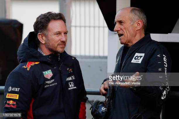 Christian Horner of Red Bull and Franz Tost of Alpha Tauri speaks in the pitlane during day one of Formula 1 Winter Testing at Circuit de...