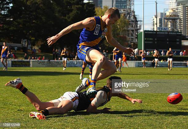Christian Howard of the Seagulls leaps over Sam Wormald of the Tigers during the VFL preliminary Final match between Williamstown and Werribee at...
