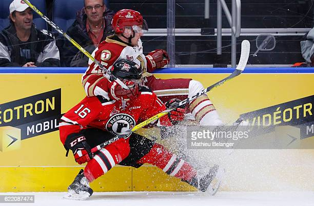 Christian Huntley of the Quebec Remparts hits Jeffrey Truchon-Viel of the Acadie-Bathurst Titan during their QMJHL hockey game at the Centre...