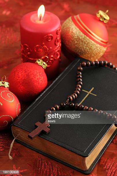 christian hymnal book with red candle rosary bead Xmas balls