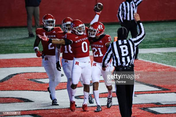 Christian Izien of the Rutgers Scarlet Knights celebrates his touchback with teammate Tre Avery against the Nebraska Cornhuskers during the second...