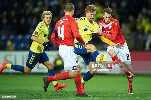 Christian Jakobsen of Brondby IF and Jens Martin Gammelby of Silkeborg IF compete for the ball during the Danish Alka Superliga match between Brondby...