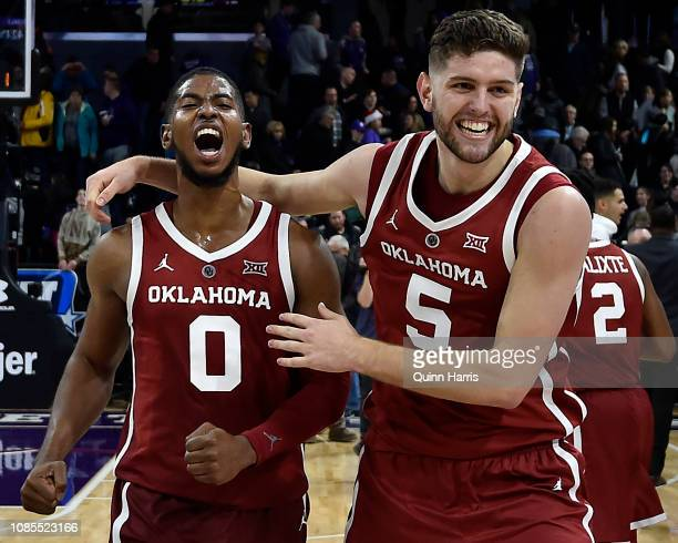 Christian James of the Oklahoma Sooners and Matt Freeman of the Oklahoma Sooners celebrate after defeating Northwestern Wildcats at WelshRyan Arena...