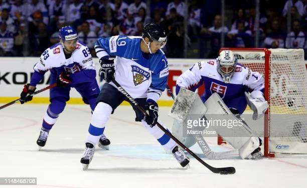 Christian Jaros of Slovakia challenges Veli Matti Savinainen of Finland during the 2019 IIHF Ice Hockey World Championship Slovakia group A game...
