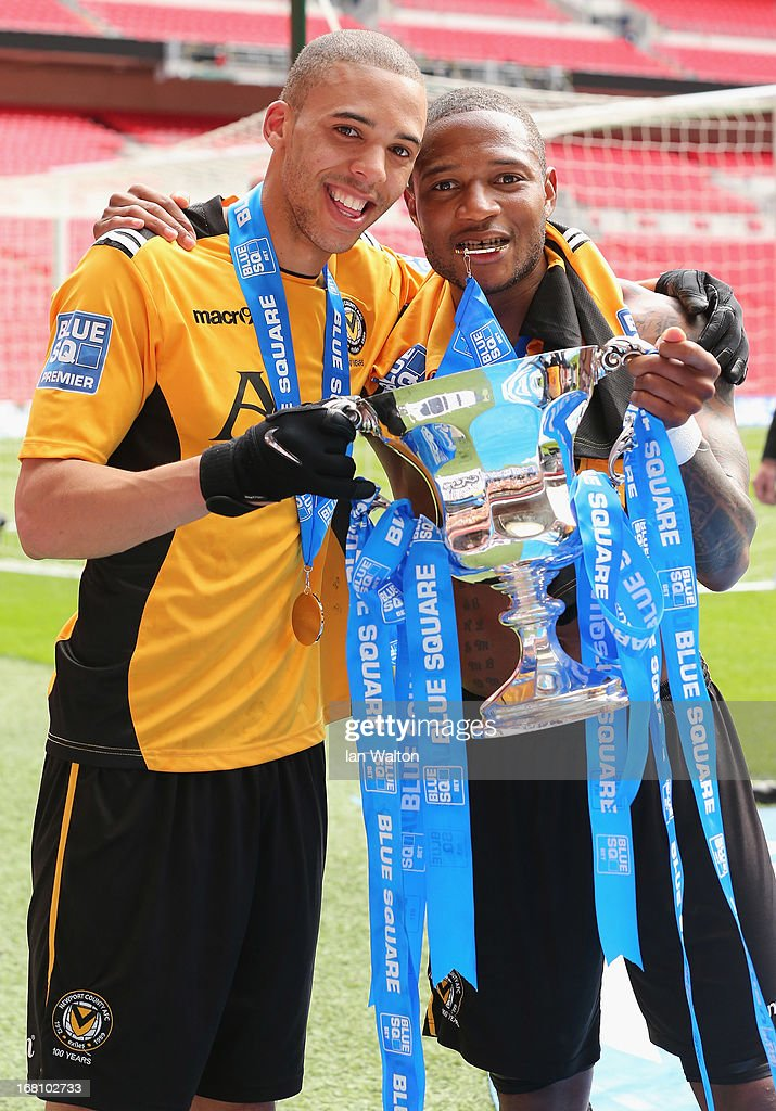 Christian Jolley and Aaron O'Connor of Newport County celebrate with the trophy after winning the Blue Square Bet Premier Conference Play-off Final between Wrexham and Newport County A.F.C at Wembley Stadium on May 5, 2013 in London, England.