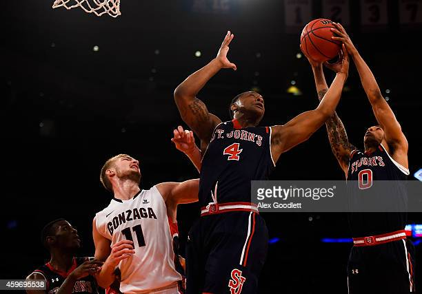 Christian Jones and Jamal Branch of the St John's Red Storm attempt a rebound over Domantas Sabonis of the Gonzaga Bulldogs in the first half at...