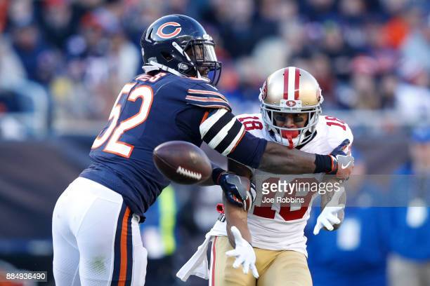 Christian Jones of the Chicago Bears attempts to break up the pass intended for Louis Murphy of the San Francisco 49ers at Soldier Field on December...