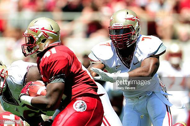 Christian Jones of the Gold Team pursues Brad Abram of the Garnet Team during Florida State's Garnet and Gold Spring game at Doak Campbell Stadium on...