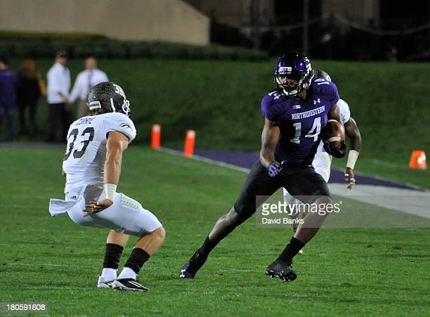 Christian Jones of the Northwestern Wildcats is pursued by Justin Currie of the Western Michigan Broncos during the first half on September 14 2013...