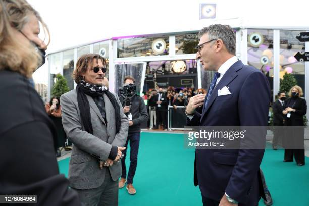 Christian Jungen welcomes Johnny Depp at the Crock of Gold A few Rounds with Shane McGowan premiere during the 16th Zurich Film Festival at Kino...