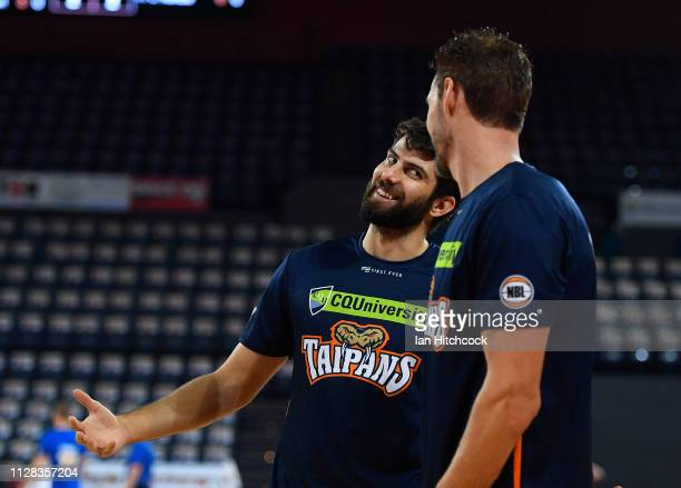 Christian Jurlina and Alex Loughton of the Taipans share a laugh during the warm up before the start of the round 17 NBL match between the Cairns...