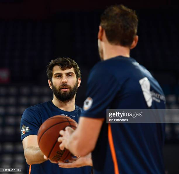 Christian Jurlina and Alex Loughton of the Taipans warm up before the start of the round 17 NBL match between the Cairns Taipans and the Brisbane...