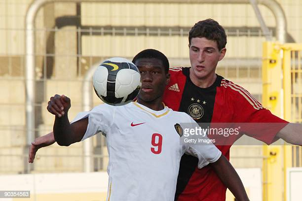 Christian Kabasele of Belgium challenges Manuel Schneider of Germany during the U19 international friendly match between Belgium and Germany at the...