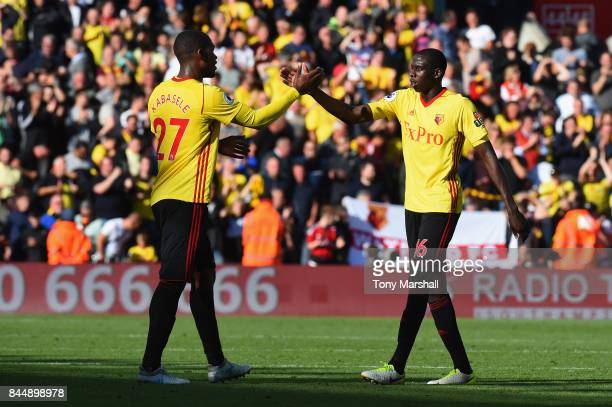 Christian Kabasele of Watford and Abdoulaye Doucoure of Watford celebrate after the full time whitsle during the Premier League match between...