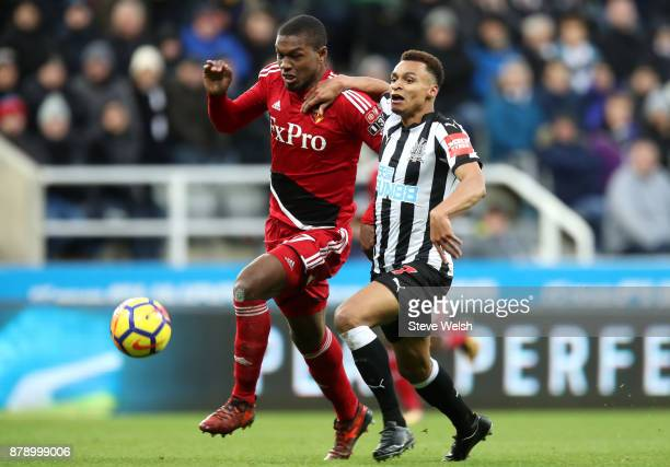 Christian Kabasele of Watford and Jacob Murphy of Newcastle United battle for possession during the Premier League match between Newcastle United and...