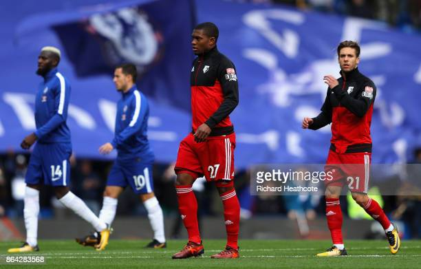 Christian Kabasele of Watford and Kiko Femenia of Watford make their way out onto the pitch during the Premier League match between Chelsea and...