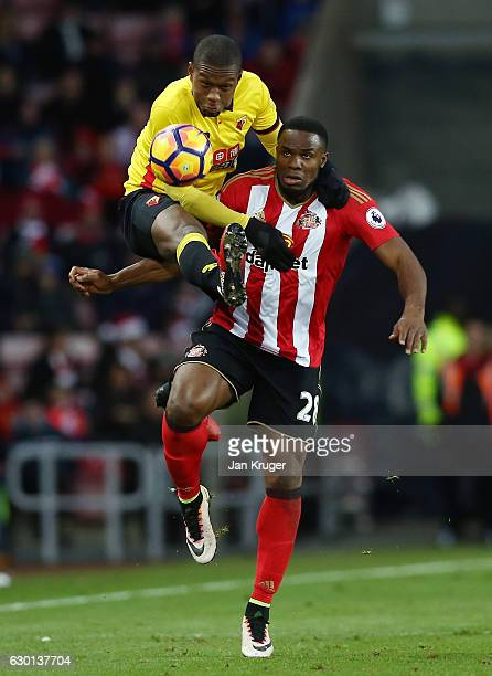 Christian Kabasele of Watford and Victor Anichebe of Sunderland battle to win a header during the Premier League match between Sunderland and Watford...