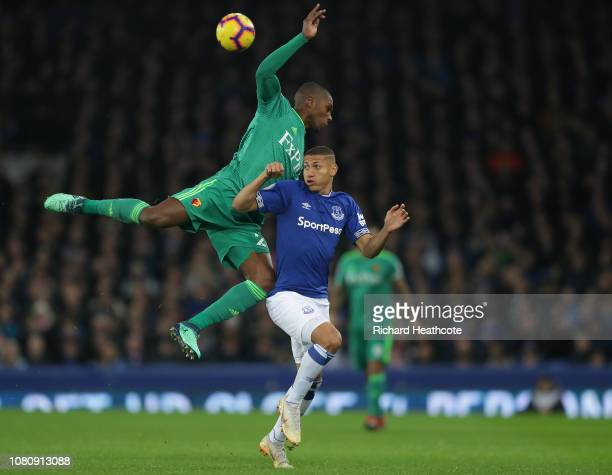 Christian Kabasele of Watford battles with Richarlison of Everton during the Premier League match between Everton FC and Watford FC at Goodison Park...
