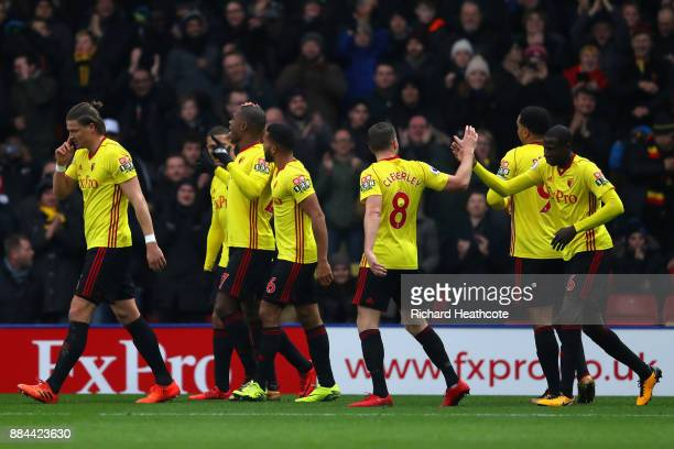 Christian Kabasele of Watford celebrates after scoring his sides first goal with his Watford team mates during the Premier League match between...