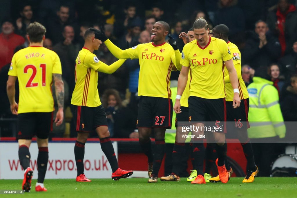 Christian Kabasele of Watford celebrates after scoring his sides first goal with his Watford team mates during the Premier League match between Watford and Tottenham Hotspur at Vicarage Road on December 2, 2017 in Watford, England.
